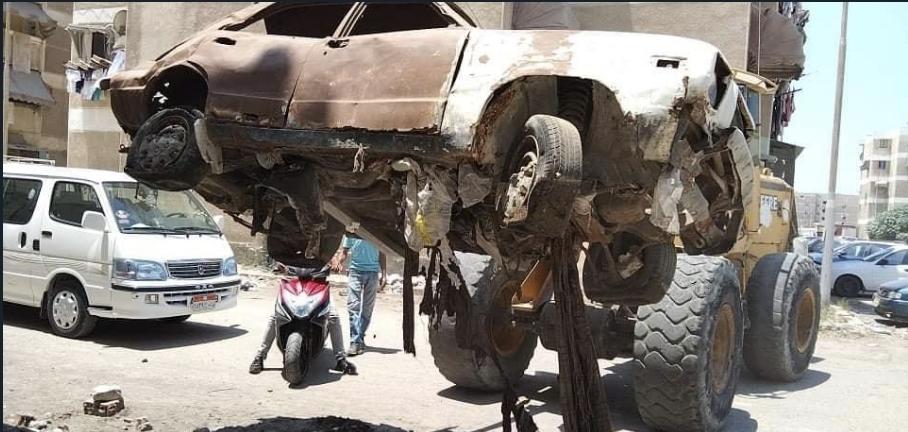 حملة مكبرة لرفع السيارات المتهالكة من شوارع ضواحي بورسعيد